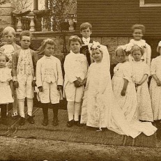"Helen Marie Hoagland, second child on the left side of this photo, was my biological paternal grandmother. She took part in this ""Tom Thumb Wedding"" in Elgin, Kane County, Illinois."